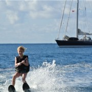 Kids waterskiing in front of Pacific Wave