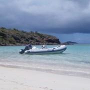 New Caribe DL15 dinghy anchored off beach BVI