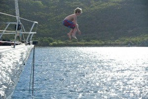 Jumping off the bow of SY Pacific Wave