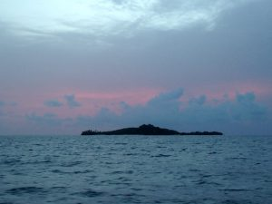 Departing the BVI onboard Pacific Wave watching a pink sunrise behind Sir Richard Branson's Necker Island