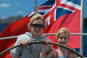 Kids having fun sailing onboard Pacific Wave