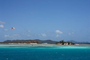 Kitesurfing off Happy Island Bar Union Island SVG photographed from SY Pacific Wave on a Grenadines Yacht Charter