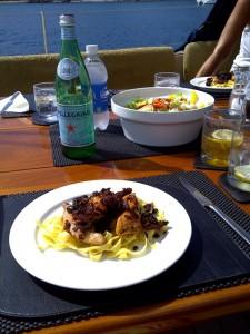 Mediterranean Chicken served on a bed of Fettuccine Pasta
