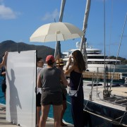 Photoshoot team on the dock alongside Pacific Wave