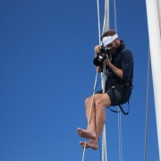 Jeff Bark photographer for Louis Vuitton up the rigging of SY Pacific Wave