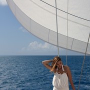 Bikini model posses beneath the sail