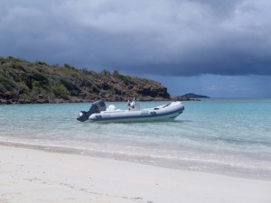 New Caribe DL15 dinghy anchored off beach BVI
