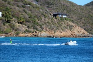 Kids wake boarding from Pacific Wave dinghy