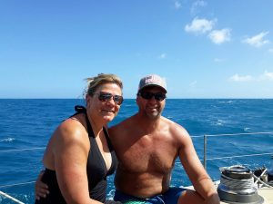 Charter guests Todd & Julie onboard Pacific Wave on a BVI Crewed Yacht Charter