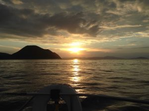 Pacific Wave sailing into the sunset on a BVI Crewed Yacht Charter