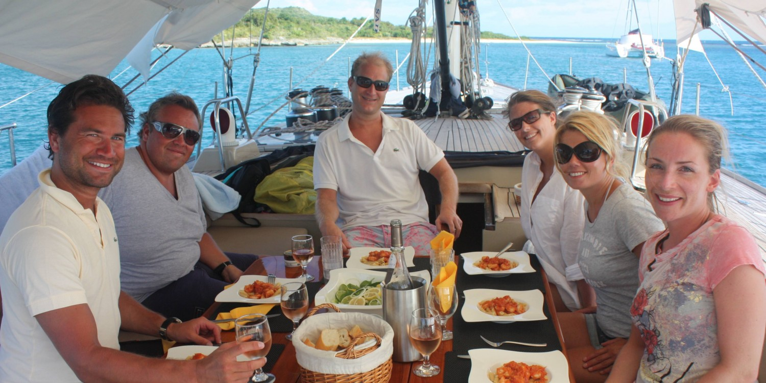 SY Pacific Wave Charter Guests Dining Ondeck