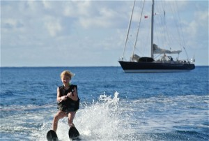 Kids Waterskiing in front of SY Pacific Wave
