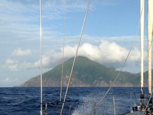 Saba on the bow as we sail on Pacific Wave towards the Caribbean island