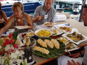 Judges sampling the cuisine onboard Pacific Wave at the Antigua Yacht Show